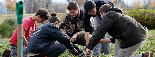 Students working in campus farm's garden