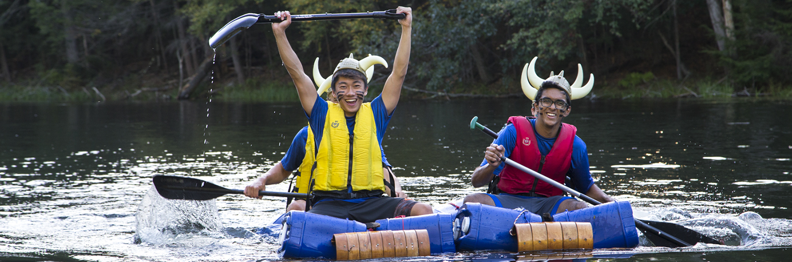 Students in fun boat race, wearing costumes