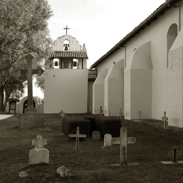 Photo of a California mission church and graveyard