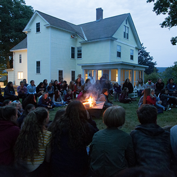 Students gather around a campfire as the 2017-18 NMH school year begins.