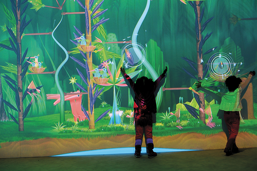 Jungle projection with children silhouettes waving their arms