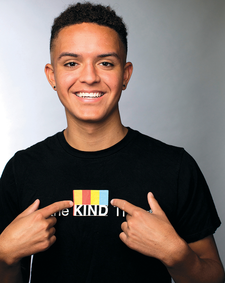 Dillon points to the word KIND on the T-shirt he's wearing